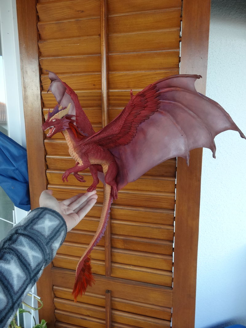sculpture commission artwork dragon furry companion balanced  Painting the wings and back