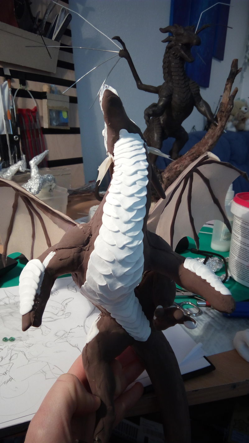 sculpture commission artwork companion dragon treasure rock mountain Laying down big scales. What a terrible contrast!