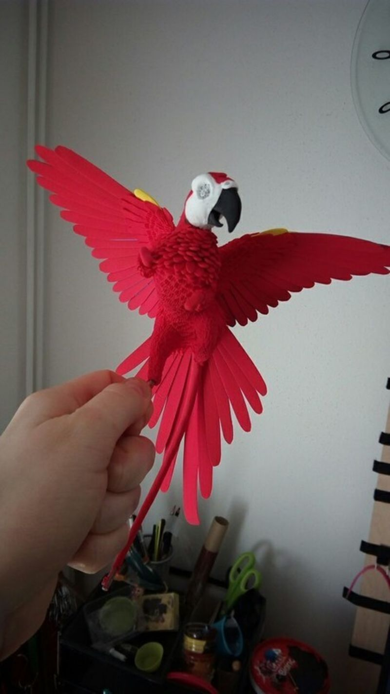 sculpture commission artwork companion parrot macaw bird gryphon mythology  griffin balanced eurofurence 23 red macaw