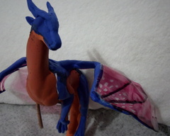 sculpture commission artwork balanced companion  dragon